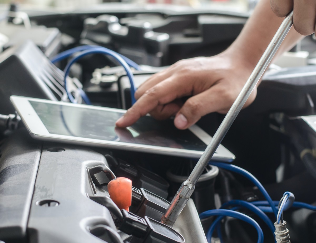 Diagnostic Tablet on engine transmission sensor